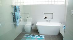 This full bathroom renovation transformed the room into a modern masterpiece. Great interior design with all the latest bathroom products from Highgrove Bathrooms. Frameless Shower Panels with Back to Wall Toilet Suite and Freestanding Bath Toilet Suites, Back To Wall Toilets, Freestanding Bath, Frameless Shower, Shower Panels, Bathrooms, Bathtub, Australia, Homes