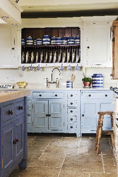 Yes there are uppers but the plate rack is fabulous and each lower cabinet is on feet like a standing furniture piece.