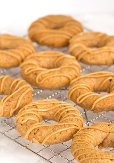 Apple Peanut Butter Dognuts - the doggy donut made for the pups in your life. They're peanut butter and apple flavored with a peanut butter drizzle.
