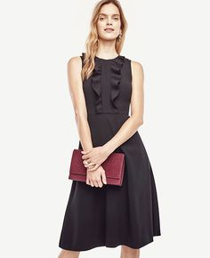 """Finished with a cascading ruffle, our smooth crepe flare dress is pretty, polished and perfectly flattering. Jewel neck. Sleeveless. Hidden back zipper with hook-and-eye closure. Lined bodice. 25 1/2"""" from natural waist."""