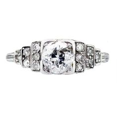 Platinum and Diamond Vintage Engagement Ring pretty setting on this one:)