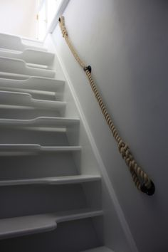 A 24mm synthetic hemp rope banister with steel wall brackets handmade by a blacksmith!