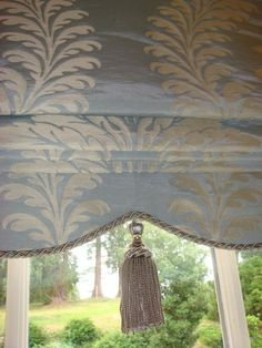 Ooh. Perfect! This is a great shape for the shade. The tassel in the middle and the cording around the trim are perfect. My material may not lend itself to this direction toward elegance though.