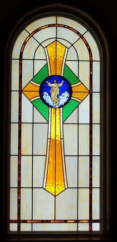 """DbyD-7323.  These Stained Glass Windows with a Cross and a """"Life of Christ"""" Scene Painted Medallion in the center can be found in Brantley United Methodist Church in Brantley, Alabama.  They were designed to match the Stained Glass we did in a pair of doors we did on the rear of the church that we did a number of years earlier."""