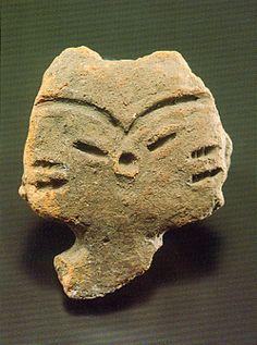 "Japanese ceramic figurine ""DOGU"".   The face like the cat. Knob of china. Nagano japan. BC.3,500 - BC.2,500."