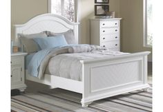 white king bed at the brick
