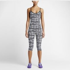 Nike Bodysuit Black, white @ grey w/ attached black bra.  Bra has foam pads.  Adjustable straps.  Really cute, just a bit low cut for me. Nike Other
