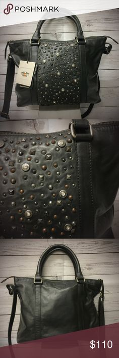 Harley-Davidson® Studded Tote Bag Gorgeous, soft, vintage black leather tote with amazing studding and rhinestone detailing. Attached strap to wear at shoulder. Zipper closure, with two slot pockets at interior and one interior zipper pocket. Embroidered BAR AND SHIELD at back. 97800-16VW Harley-Davidson Bags Totes
