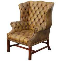 Grand Scale English Tufted Leather Wingback Chair | From a unique collection of antique and modern chairs at https://www.1stdibs.com/furniture/seating/chairs/