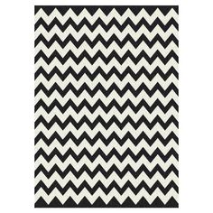 Tufted chevron rug. Product: Rug  Construction Material: Nylon  Color: Black and white  Features:   Tufted     Made in the USA        Note: Please be aware that actual colors may vary from those shown on your screen. Accent rugs may also not show the entire pattern that the corresponding area rugs have.