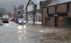 Streets in Scotland, such as here in Ballater, have today flooded Huge Waves, Britain, Scotland, Fire, Darkness, Centre