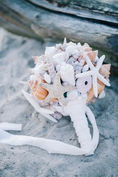 now that's a beach inspired bouquet with seashells!