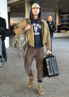 Best Celebrity Street Styles: Shia Labeouf, who's had a few run ins with the law cheekily wears an NYPD Blue Hoodie with a Brown and Tan ensemble. Follow rickysturn/mens-casual for more Hot Trends