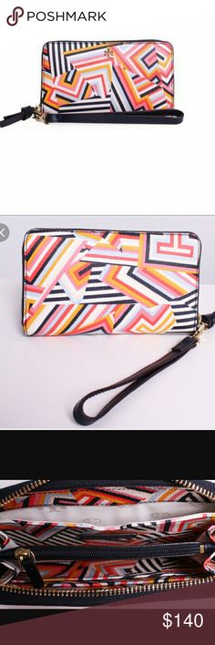 "Brand new authentic Tory burch wristlet/wallet Zipper closure Detachable wrist strap 1 smartphone pocket, 3 bill pockets, 1 zipper compartment Fits an iPhone 6 Length: 6.45"" (16.2 cm) Width: 3.98"" (10.0 cm)   Printed vinyl  Sorry no trades! Will ship same or next day.  Will accept reasonable offers, PLEASE DO NOT SEND LOWBALL OFFERS !! Tory Burch Bags Clutches & Wristlets"