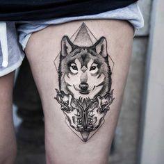 Pretty leg wolf tattoo.