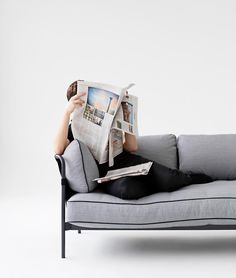 A relaxing Saturday with the Can sofa reading the daily newspaper. Designed by Ronan & Erwan Bouroullec. #HAY #HAYdesign