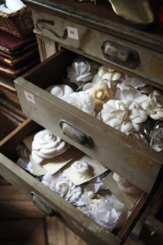 Camellias in Chanel's Maison Lemarie atelier. Assembled petal by petal. Each different style is recorded and kept in the archives.