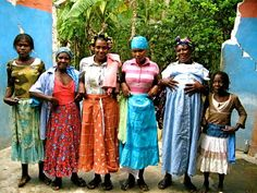 Traditional dress for woman in Haiti is a long, colorful skirt, a blouse and a headscarf.