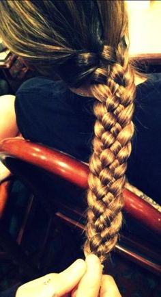 This looks really hard but it's really just a simple fish tale braid (FYI this braid is for long hair)