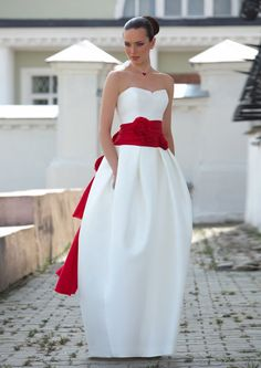 I'm liking the unique silhouette of this gown.  And @Amy Brozovich, it has pockets for snacks!!!  ;)    Fashion white  mikado wedding dress  with red by EdelweissBride, $640.00