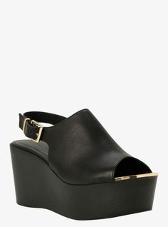 Break out of the box with these peep-toe beauties. This black faux leather wedge is your perfect everyday look with a modern twist. This sleek style has a gold tone metal trim that gives it a classy touch.