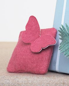 Cute Butterfly on a sachet.  Iron 2 different colored pieces of felt together with fusible webbing, then cut it out.