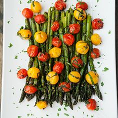 Low effort, high payoff!  Roasted cherry tomatoes with mint (served here with roasted asparagus).
