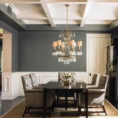 A beautiful coffered ceiling adds structure and elegance to a formal dining room. (Walls are Calico Rock DE6229; Ceiling/Trim is White Picket Fence DET648) #DunnEdwards #DEoriginalhome #ThenNowForever #paint #homedecor #interiordesign #diningroom #traditional