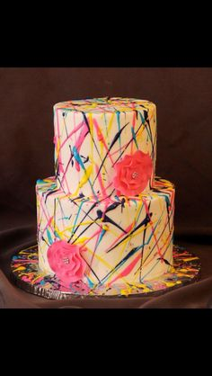 "Danielle's 4th - Loved doing this cake!  Buttercream with royal icing ""splatter"""