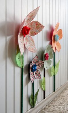 make wall flowers out of felt that kids could assemble!