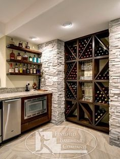 Wine storage and small bar for basement; by Finished Basement Company Finished Basement Company, Finished Basement Designs, Basement Bar Designs, Basement Bars, Basement Ceilings, Cool Basement Ideas, Open Basement, Basement Kitchenette, Basement Layout