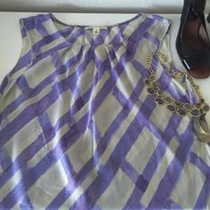 Banana Republic - Sleeveless Silk Top Beautiful watercolor windowpane print in shades of lavender and lilac. So pretty to wear out with dressy shorts and heels!  100% silk, hand wash or dry clean (I will dry clean before shipping to you and include the receipt). Banana Republic Tops