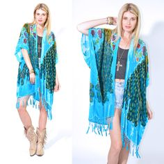 From SALDANA VINTAGE Gorgeous vintage inspired burnout velvet Kimono Cape.  Draped style that will fit most sizes        *  Gorgeous peacock design  *  Hand beaded accents  *  Fringe and beads hem  *  Open style front  *  Sheer  *  Hand made in the USA  *  Imported fabric    Contents: silk, rayon  Color: Turquoise  A...