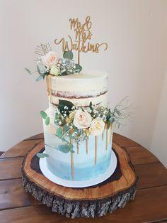 Wedding cake. Blue. Pink. Australian natives. 2 tier. Semi naked. Buttercream. Gold drip.
