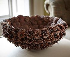 What a beautiful bowl! No instructions but I would use a regular bowl as the template and hot glue away.