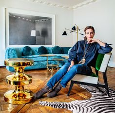 Why India Mahdavi Is a Designer to Know Now - At home in Paris, India Mahdavi mixes her own Gelato chair, Bishop table (shown in limited-edition gold), and Jelly Pea sofa with vintage and designer pieces.Photo: Matthieu Salvaing