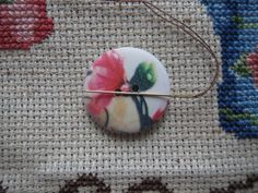 Never lose a needle again! This beautiful pink floral needle minder is made with wooden buttons and strong magnets! The back magnet has a Needle Minders, Magnets, Strong, Buttons, Floral, Pink, Beautiful, Florals, Hot Pink