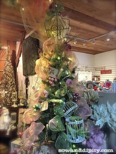 Unusual Props for Creative Christmas Trees - Bust form dress tree with birds and a bird cage!