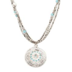 Just in time for season's change, the Mallory medallion necklace has an artsy, one of a kind appeal that we're loving. Bright aqua CZ's pepper throughout the antiqued metal of Mallory's large sun-like medallion. This beachy triple strand beauty will work great on its own or layered with additional chains.  Find it on Splendor Designs