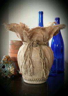 Glass vase, fabric stiffener, burlap and jute.