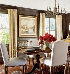 The beige-and-white damask pattern of the draperies balances the richness of the chocolate-colored walls. Dark mahogany curtain rods and rings blend in with the walls and take up no visual space.