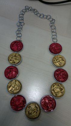 collana capsule nespresso rosse e dorate