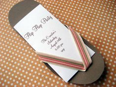 An Invitation (or Card) in the shape of a pair of flip flops or sandals. So cute!
