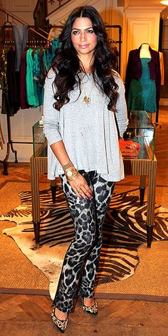 CAMILA ALVES  The future Mrs. McConaughey hits a store opening in Sao Paolo donning a loose tunic top worn over bootleg leopard-print pants and dazzling pumps.
