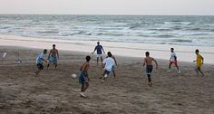 Kids Playing Soccer On Beach .