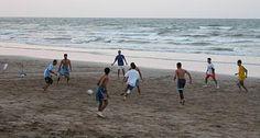 Kids Playing Soccer On Beach .