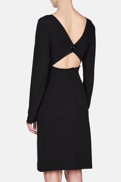 Designer Francisco Costa filled Calvin Klein's spring 2016 collection with languorous silhouettes and deconstructed details, paying tasteful homage to the DIY, grunge-inspired streetwear of the '90s. A high, gently scooped front neckline and extended long sleeves give this black dress a cozy fluidity, yet with a distinctly lightweight feel. The smooth and slightly stretchy viscose blend accents the softly sculptured shape and open, cut-out back.