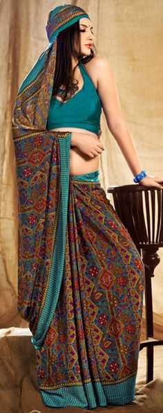 Dark teal blue color blended crepe saree is with contrast color printed motifs design with printed border and pallu.