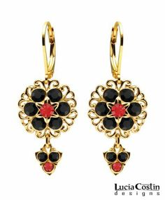 Classical Style Dangle Flower Earrings by Lucia Costin Crafted in 14K Yellow Gold over .925 Sterling Silver with Black and Red Swarovski Crystal Flowers and Fancy Charms, Decorated with Filigree Ornaments Lucia Costin. $57.00. Lucia Costin floral Dangle earrings. A perfect feminine touch. Update your everyday style with inspiration when wearing this piece of jewelry. Beautifully designed with black and light siam Swarovski crystals. Unique jewelry handmade in USA