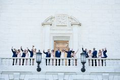 Cheering bridal party stands on marble balcony  #Michiganwedding #Michiganwedding #Chicagowedding #MikeStaffProductions #wedding #reception #weddingphotography #weddingdj #weddingvideography #wedding #photos #wedding #pictures #ideas #planning #DJ #photography #bride #groom